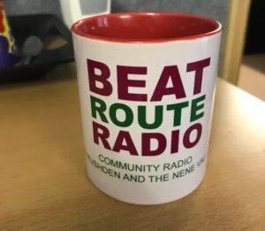 A cup with the logo Beat Route Radio, Radio for Rushden and the Nene Valley